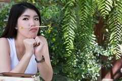 Asian woman sit at outdoor cafe. young female adult with natural Stock Photo