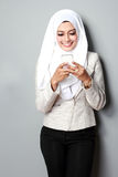 Attractive asian woman using mobile phone Royalty Free Stock Images