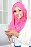 Attractive asian woman using mobile phone Royalty Free Stock Photo