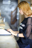 Attractive asian woman using typewriter Royalty Free Stock Photo