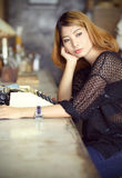 Attractive asian woman using typewriter Royalty Free Stock Image