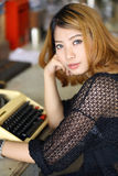 Attractive asian woman using typewriter Stock Image