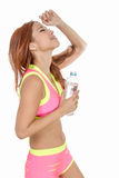 Attractive Asian woman with water bottle after exercise Stock Image
