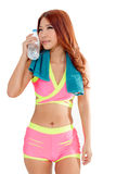 Attractive Asian woman with water bottle and towel after exercis Royalty Free Stock Photo