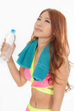 Attractive Asian woman with water bottle and towel after exercis Royalty Free Stock Image