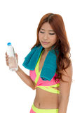 Attractive Asian woman with water bottle and towel after exercis Stock Image