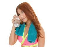 Attractive Asian woman with water bottle and towel after exercis Stock Photo