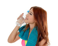 Attractive Asian woman with water bottle and towel after exercis Stock Photography