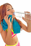 Attractive Asian woman with water bottle and towel Stock Image