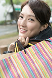 Attractive Asian young woman shopping and holding bags Royalty Free Stock Photos