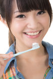 Attractive Asian young woman using toothbrush Royalty Free Stock Photo