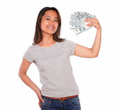 Attractive asiatic young woman holding cash money Stock Photography