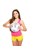Attractive athletic girl with a clock on a white background. Tim Royalty Free Stock Images