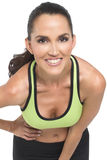 Attractive athletic woman. An attractive athletic woman leaning into camera, wearing athletic clothes Stock Images