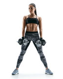 Attractive athletic woman doing a fitness workout with dumbbells. Royalty Free Stock Photos