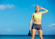 Attractive Athletic Woman Doing Kettle Bell Workout Stock Photography