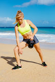 Attractive Athletic Woman Doing Kettle Bell Workout Royalty Free Stock Image