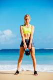 Attractive Athletic Woman Doing Kettle Bell Workout Stock Image