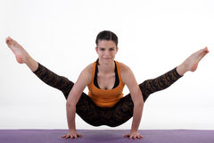 An attractive athletic woman doing a yoga pose in studio. Royalty Free Stock Photography