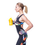 Attractive athletic woman relaxing after workout with shaker isolated over white background. Healthy girl drinks whey protein. Royalty Free Stock Images