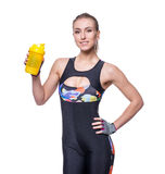 Attractive athletic woman relaxing after workout with shaker isolated over white background. Healthy girl drinks whey protein. Stock Image