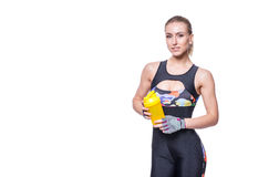 Attractive athletic woman relaxing after workout with shaker isolated over white background. Healthy girl drinks whey protein. Cop stock images