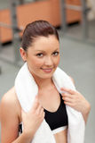 Attractive athletic woman with towel Stock Image
