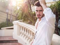 Attractive athletic young man outdoor in elegant setting Royalty Free Stock Photo