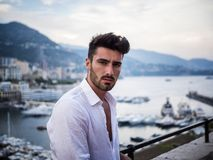 Attractive athletic young man on seaside promenade stock image