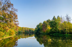 Attractive autumn landscape with beautiful reflection over lake Stock Photography