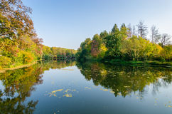 Attractive autumn landscape with beautiful reflection over lake Royalty Free Stock Photo