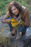 Attractive autumn woman and falling leaves Stock Images