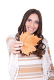 Attractive autumn woman holding leaf Royalty Free Stock Image