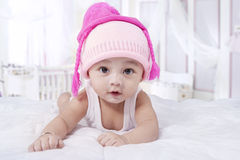 Attractive baby boy with hat on bed Royalty Free Stock Image