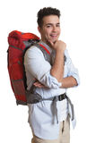Attractive backpacker looking at camera Royalty Free Stock Photography