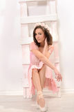 Attractive ballerina sitting on stairs Royalty Free Stock Images