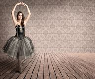 Attractive ballerina on tiptoe. In a vintage background Stock Image
