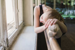 Attractive ballerina warming up in ballet class Royalty Free Stock Photo