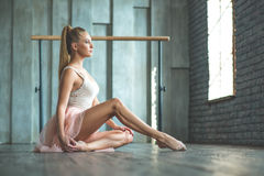Attractive ballet dancer sitting on floor Royalty Free Stock Photography
