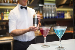 Attractive bar man making a cocktail Royalty Free Stock Photo