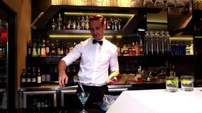 Attractive bar man making a cocktail stock video footage