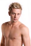 Attractive bare chested young man. Royalty Free Stock Photos