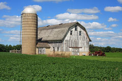 Attractive barn and silo in Wisconsin. Working farm, with attractive old barn and silo, in Wisconsin stock image