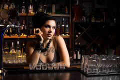 Attractive bartender. With some drinks Stock Photos