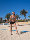 Attractive beach girl on the beach volleyball court Stock Image