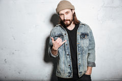 Attractive bearded hipster man gesturing with hands. Royalty Free Stock Image