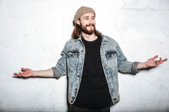 Attractive bearded hipster man gesturing with hands. Stock Photo