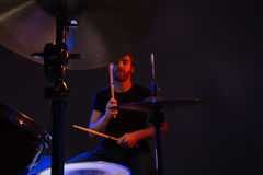Attractive bearded man drummer with closed eyes enjoying playing drums Stock Photos