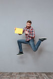 Attractive bearded man holding copyspace blank jumping Royalty Free Stock Photos