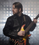Attractive bearded man  plays guitar in smoke Stock Photo